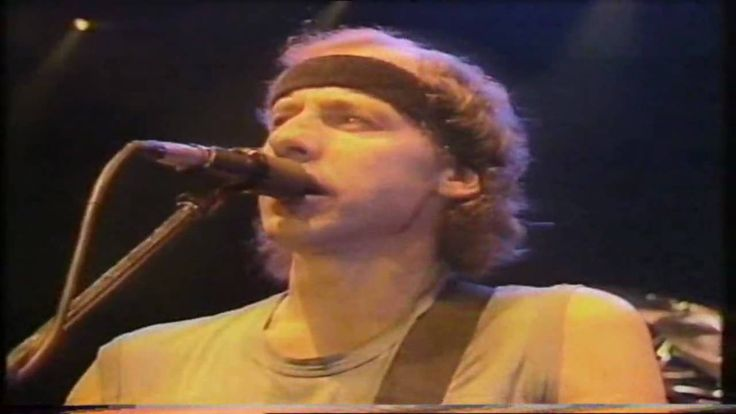"""""""Dire Straits - Walk of Life""""  Dire Straits performing live during the 'Brothers in arms'-tour at the Wembley Arena in London, United Kingdom on July 10th 1985."""
