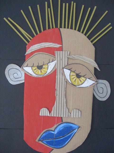 Eric Straw from St. Martha Catholic School Artists. An artist whose masks have both tribal and sometimes Cubist roots, bold features.....and that uses cardboard and only cardboard!
