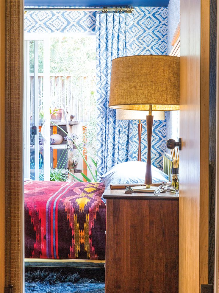 The cozy bedroom sports Pendleton Woolen Mills bedding and a '70s shag rug.: