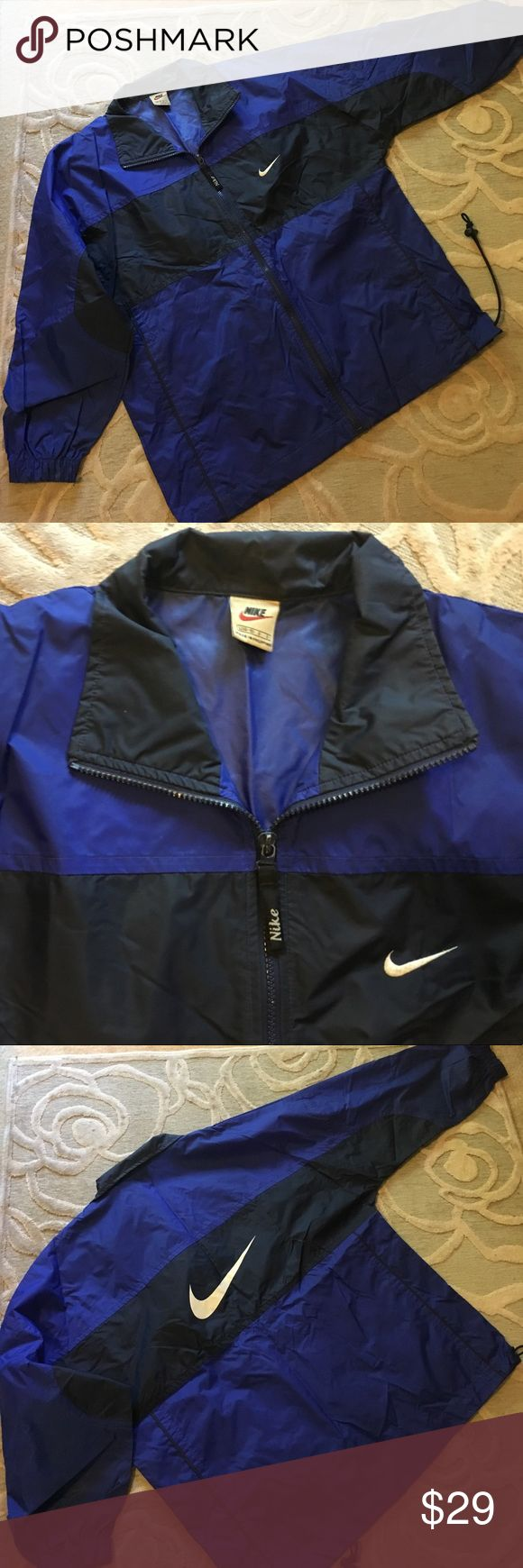 🌿NIKE🌿royal/navy blue unlined windbreaker jacket 🌿NIKE🌿royal/navy blue unlined windbreaker jacket.  Durable slick nylon perfect for rainy day or any light wear sporty jacket needs.   Zip front.  Two hidden side pockets.  Drawstring waist.  Great near new condition.  Boys large 14/16 also works for girls or small lady. Nike Jackets & Coats Raincoats