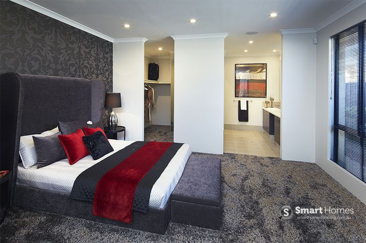 master bedroom home design. Velvet dark grey accent wall brings out the red velvet throw rugs and pillows. #mastersuite #smarthomesforliving