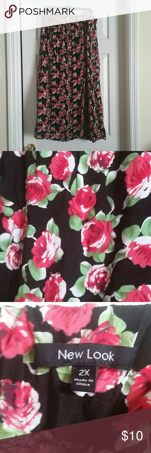 Rose printed maxi skirt Flowy and lightweight red rose printed maxi skirt on black background. Brand is new look. Elastic waist, has belt loops, does not come with belt. No rips or stains. Reasonable offers accepted. Smoke free, pet friendly home. New Look Skirts Maxi