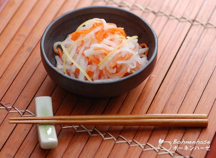 Kōhaku Namasu: a thinly sliced raw vegetable salad made with radish, carrot, lemon peel, sugar, vinegar and mirin (a rice wine similar to sake)    http://en.wikipedia.org/wiki/Mirin