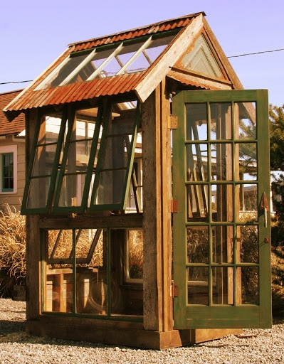 This rustic greenhouse is made entirely from reclaimed and recycled materials
