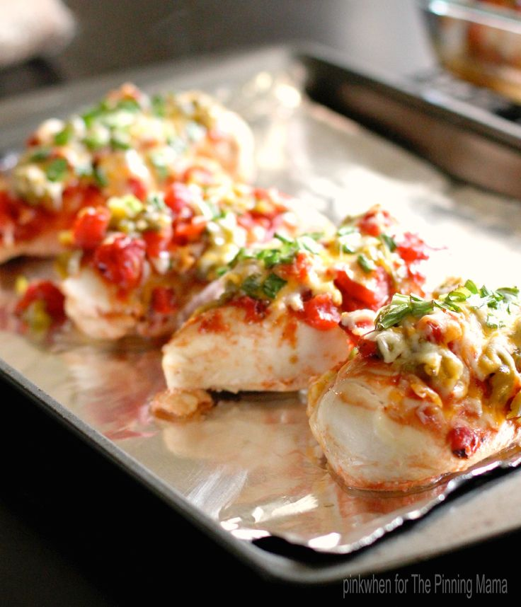 Monterrey Chicken Bake --4-6 boneless skinless chicken breasts,  1 (14.5oz) can of diced fire roasted tomatoes,  1 (4 oz) can green chilies,  1 c mexican shredded cheese,  1/2 c green onion,  1/4 c BBQ sauce==Put chicken in 9 x 12 glass baking dish. Brush chicken with BBQ sauce. Cover the chicken with the tomatoes (do not drain) and chilies. Bake at 350 for 45 min. Remove chicken from oven and cover with cheese and green onion. Bake an additional 15 minutes. Allow to cool before serving.