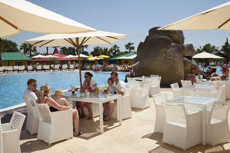 Relax by the pool with a glass of something cool. http://www.canvasholidays.co.uk/spain/spain/cd02y/cambrils-park