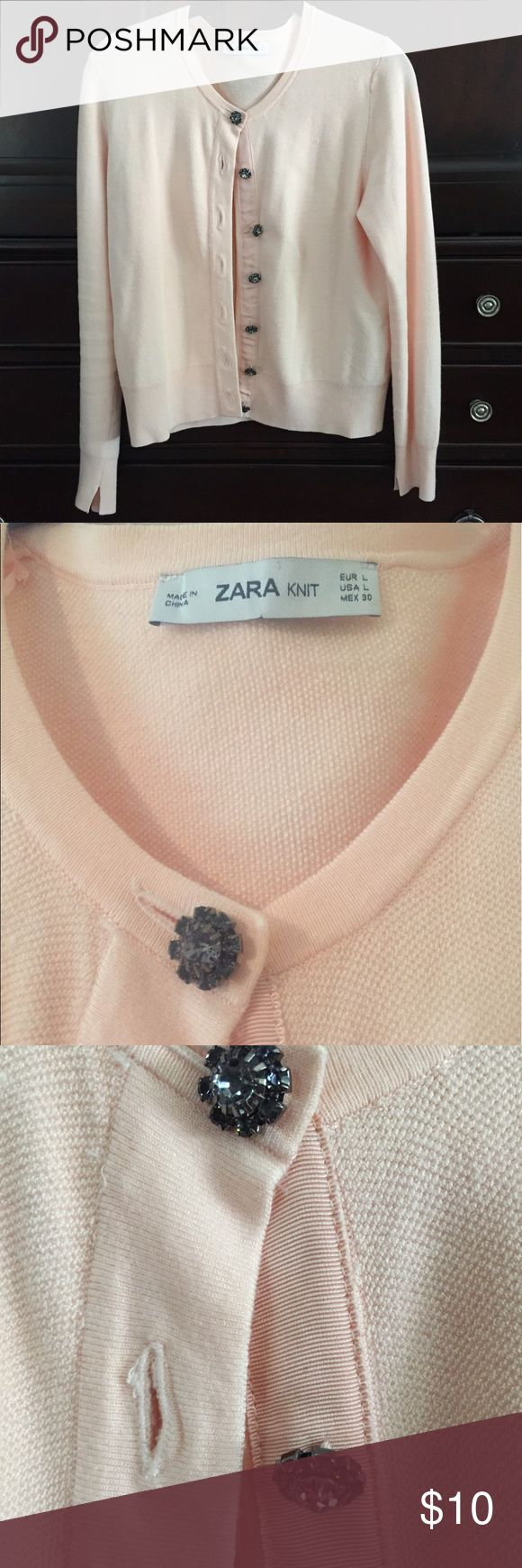 Zara knit cardigan with jeweled buttons Size Large light pink cardigan purchased this spring. Worn only a couple of times. The sparkling / jeweled buttons are all intact and lovely. Pictures show there is some pulling that you would find with this kind of material.  Very comfortable. Zara Tops