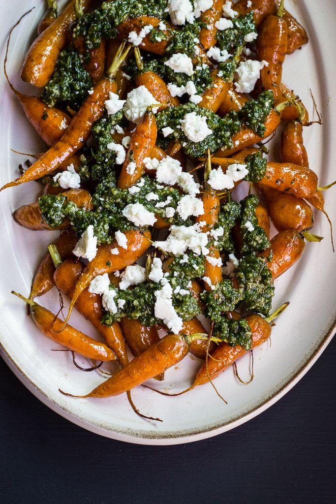 Roasted Carrots with Carrot-top Pesto & Goat Cheese by Bella ofFul-filled While browsing the stands at the farmers market, you will be sure to find bundles of carrots with their ferny tops still attached. The delicate greenery dangles from the bright orange roots making for a beautiful freshly-harvested display. Whenever I bring home a bunch …