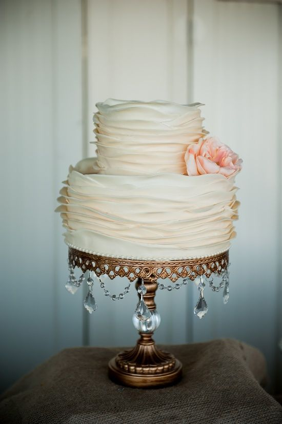 A simple or small cake can be made to look more expensive or more elegant by using a tall cake stand with bling! THIS one happens to be made from lighting parts