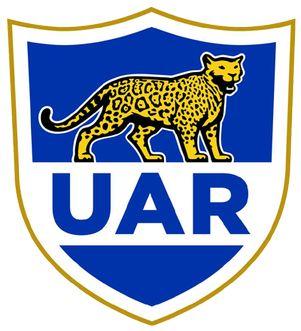 Esto logo es de un equipo de Argentina. Los jugadors jugando rugby. Hay un jaguar.
