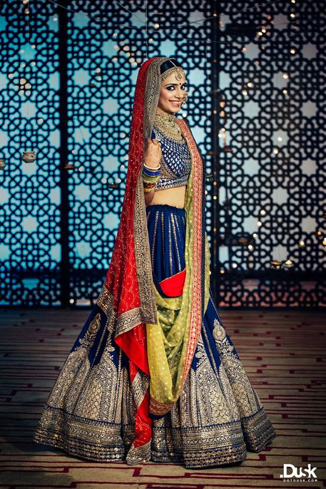 Stunning Bride in Royal Blue Lehenga | Photo Credits : dotdusk studios