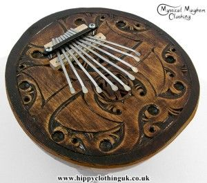 Beautiful Indonesian Carved Coconut Thumb Panio. http://www.hippyclothinguk.co.uk/product-category/gifts/musical-instruments/hippy-thumb-pianos/