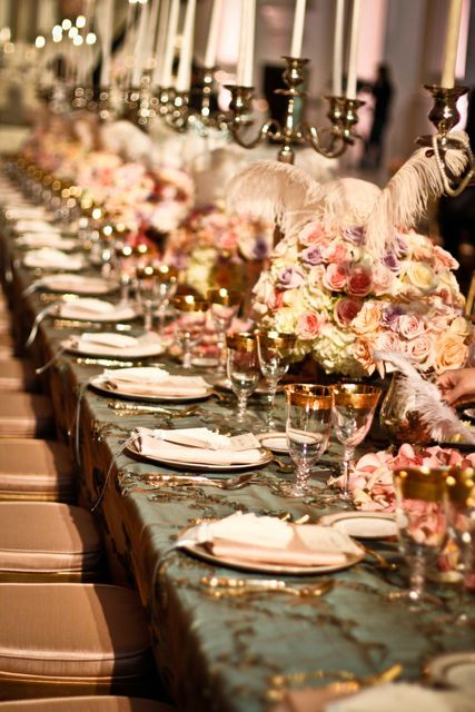 Pastel rose centrepieces accent this opulent and glamorous wedding table decor.