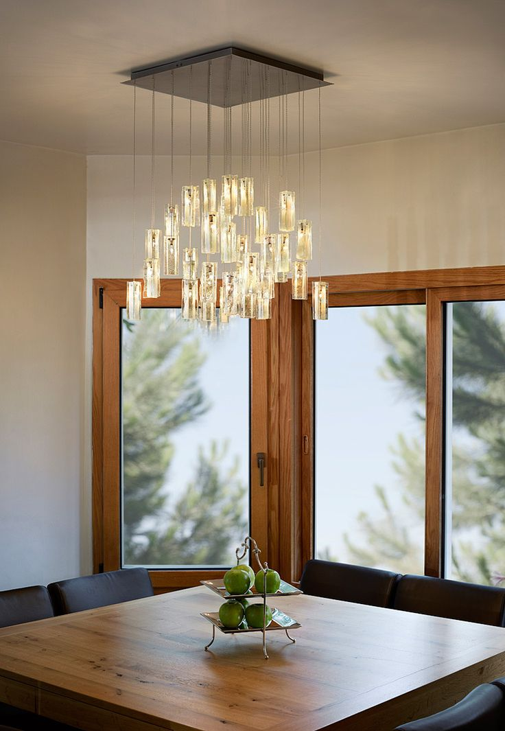 A Beautiful Modern Pendants Light Chandelier Over Dining Table By Galilee Lighting The