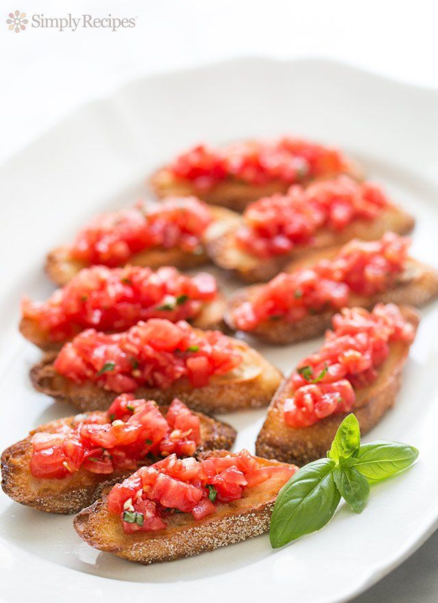Bruschetta with tomato and basil! Chopped fresh tomatoes with garlic, basil, olive oil, and vinegar, served on toasted slices of French or Italian bread. On SimplyRecipes.com