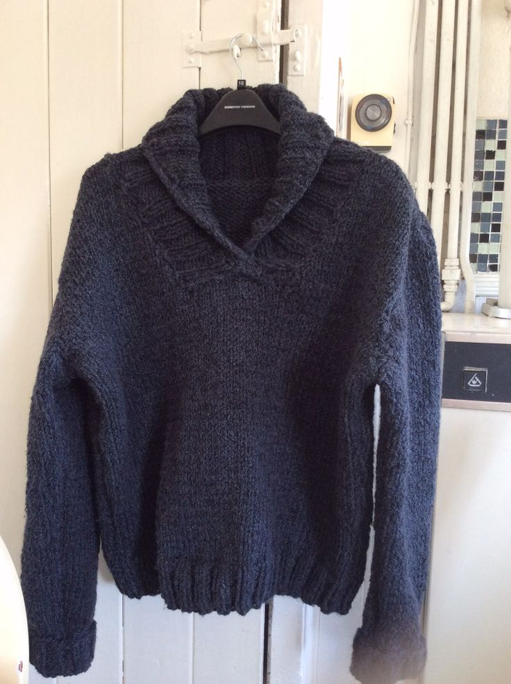 I knitted this for my son. It has a big shawl collar. The pattern is available from Ravelry. It suggests using double knit yarn, holding double strands of wool. I used chunky yarn which was a cotton/wool mix, making it both lightweight and cosy. The pattern is titled 'Boy meets Purl'