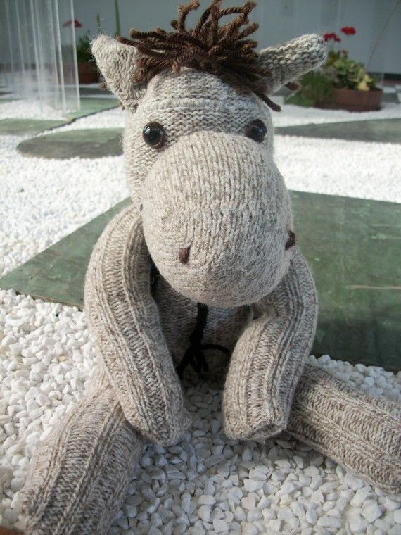 This sock horse, would make a great pal, for any guy or gal. Made from wool socks, with a yarn mane and tail.
