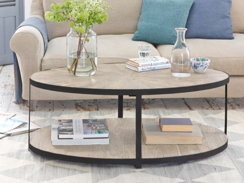 Sunshine is our oval shaped coffee table hand carved by our skilled craftsmen out of gorgeous reclaimed elm with gorgeous metal detailing.