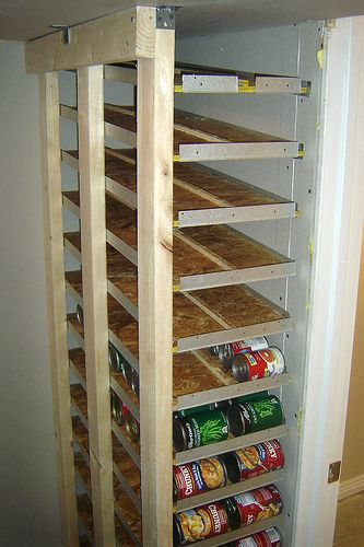 So Cool! This DIY food storage system is a fantastic way to utilize a small space to hold as many items as possible. The slant of the shelving allows cans to roll out with ease for rotation or restocking.