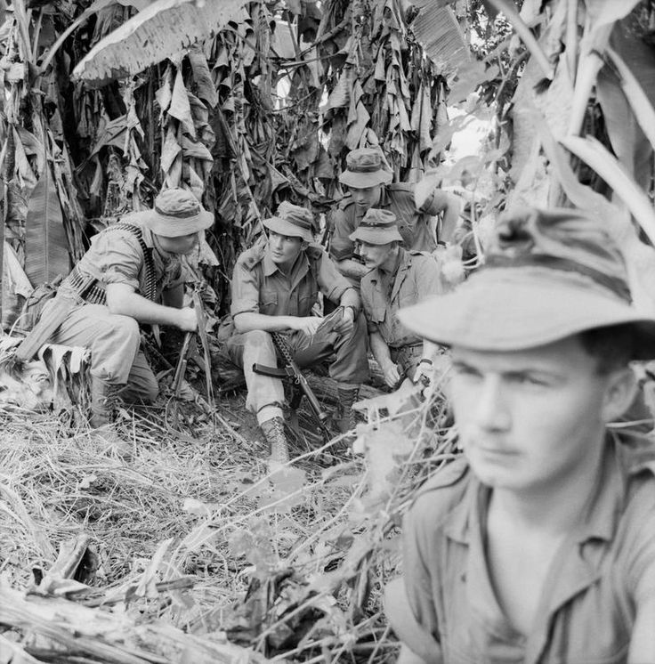 While operating in Borneo during the Indonesian Confrontation, a jungle patrol of the 1st Battalion The Royal Ulster Rifles takes advantage of a short halt in a banana plantation. The Platoon Commander is discussing the next phase of the operation with his Platoon Sergeant and two of his Non-Commissioned Officers.