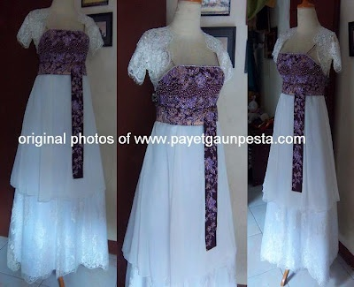 a wedding dress design combining European style with Indonesian traditional Batik fabric