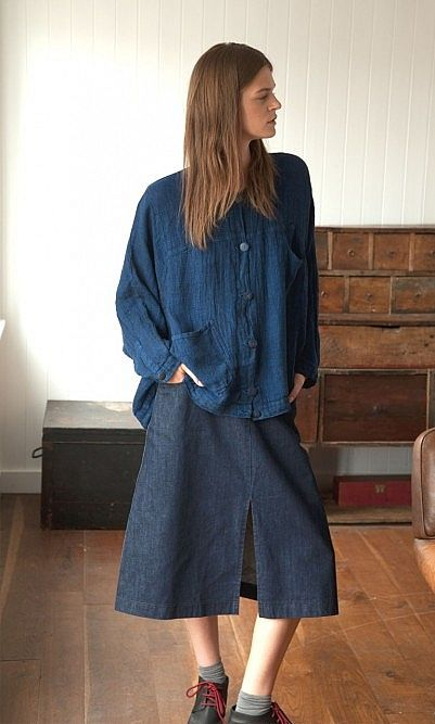 Boxy cut shirt jacket made from textured indigo cotton shot through with  electric blue thread.