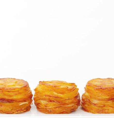 Mini Pommes Anna...four ingredients...potatoes, butter, salt, pepper...cut and stack....I could do this! Gorgeous to look at, yummy to eat. Hint: Use Yukon Gold potatoes for best flavor