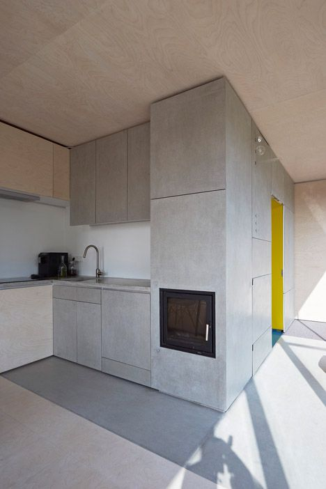 House at the pond by Hammerschmid Pachl Seebacher Architekten - walls, floor, ceiling and furniture are all made of a white oiled birch plywood that contrasts with the dark timber cladding.