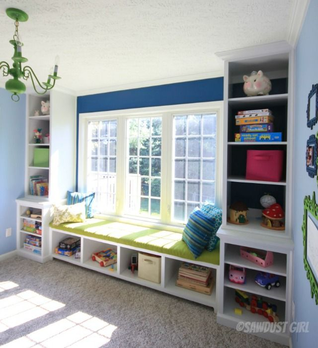 Awesome playroom built-in window seat and bookshelf storage.   http://sawdustdiaries.com