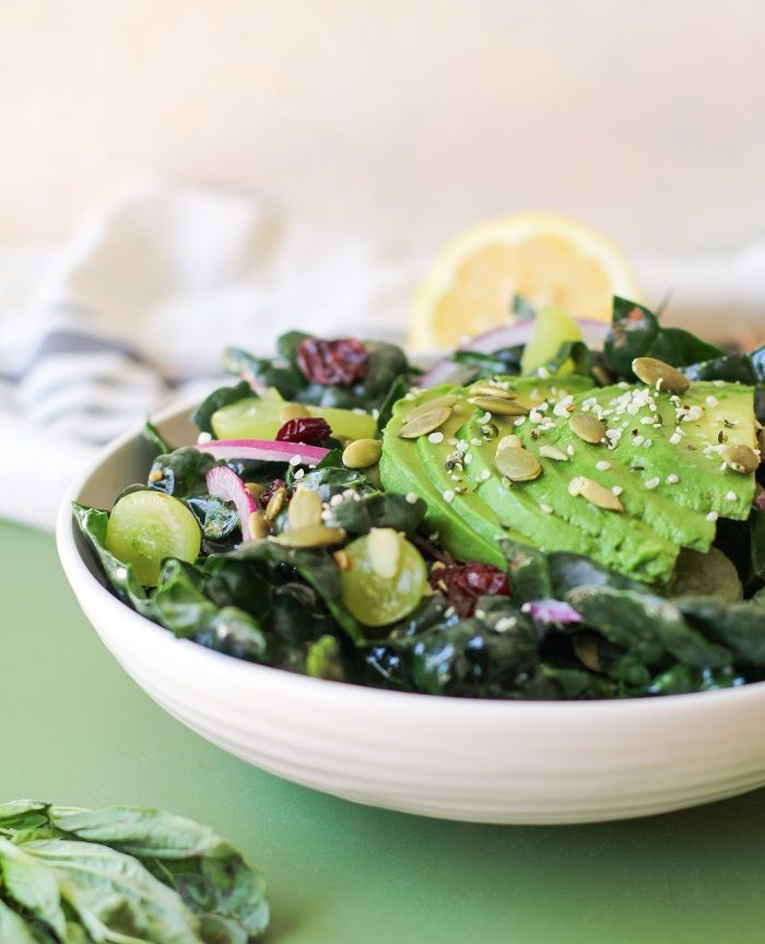 """Squeaky clean summer kale salad with avocado, red onion, pumpkin seeds, and lemon-basil dressing. You guys, I almost did something silly. I almost named this salad, """"The Best Damn Kale Salad Ever.""""…"""