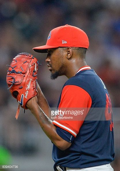 Atlanta pitcher Julio Teheran looks in towards the catcher for the sign during a game between the Colorado Rockies and the Atlanta Braves on August 25, 2017 at SunTrust Park in Atlanta, GA. The...