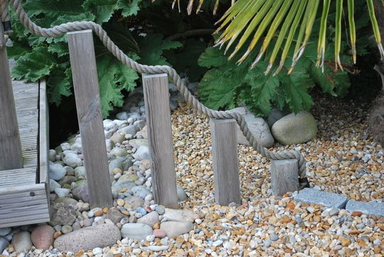 Seaside garden - love the use of stones and pebbles.