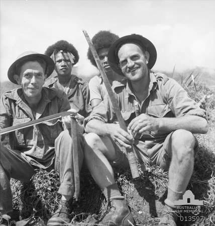 1942-11-19. New Guinea. Kokoda. Australians display a Japanese sword and bayonet.
