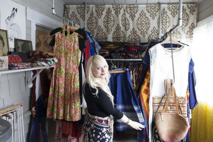 A small room at the back of the house operates as Ana's vintage clothing store, Oh Ana. Ikat Curtains are Zulily. Ana dip-dyed the sheer white curtains in tumeric to create the yellow ombre effect.