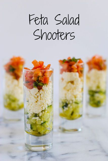 Feta Salad Shooters - layers of crunchy cucumber, tangy feta, and fresh tomato and basil. A perfect, simple party bite for the summer! | foxeslovelemons.com
