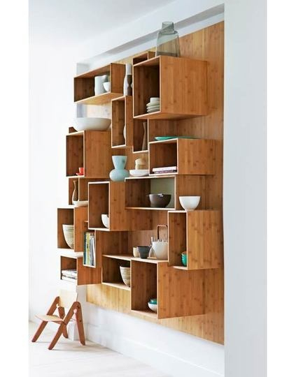 Interesting wall of open shelving could be used lieu china cabinet.