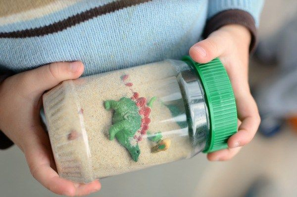 Make a dinosaur sensory bottle - a FUN discovery bottle for your dinosaur-loving kid!