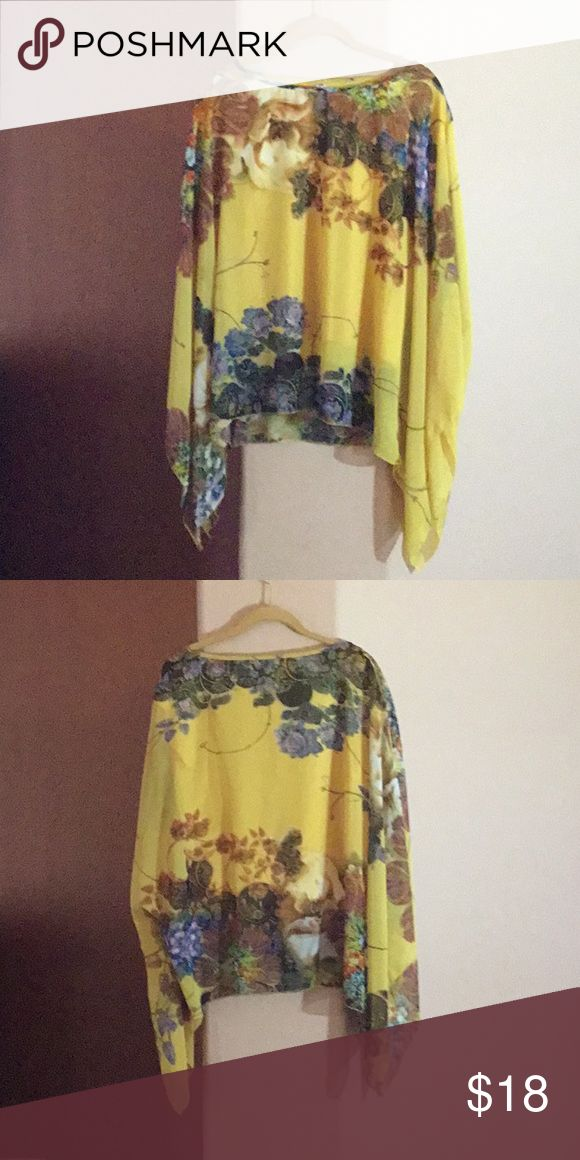Vibrant color, batwing top Vibrant colors on this beautiful batwing top. Beautiful yellow, brown, blue and green. Tops Tunics