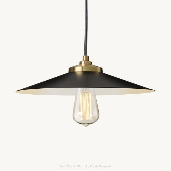 """The Black & Gold Empire Pendant featuresa satin black shade with white interior and brass detailing. Itdraws it's inspiration from the classic industrial""""factorylamp shade"""" of the 1920's. However, in this instance, the focusis on elegance in addition to functionality, evident in the use of solid brass materials anda silhouettethat echoes our signature Hoi P'loy profile.   The brass and metalcomponents that make up the light are allmade and carefullyassembled in Cape Town. The…"""