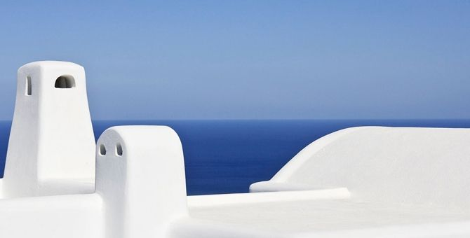 Cob-Traditional-Chimneys-SeaView-Sky-Sun-Santorini-Pyrgos-Greece-Summer