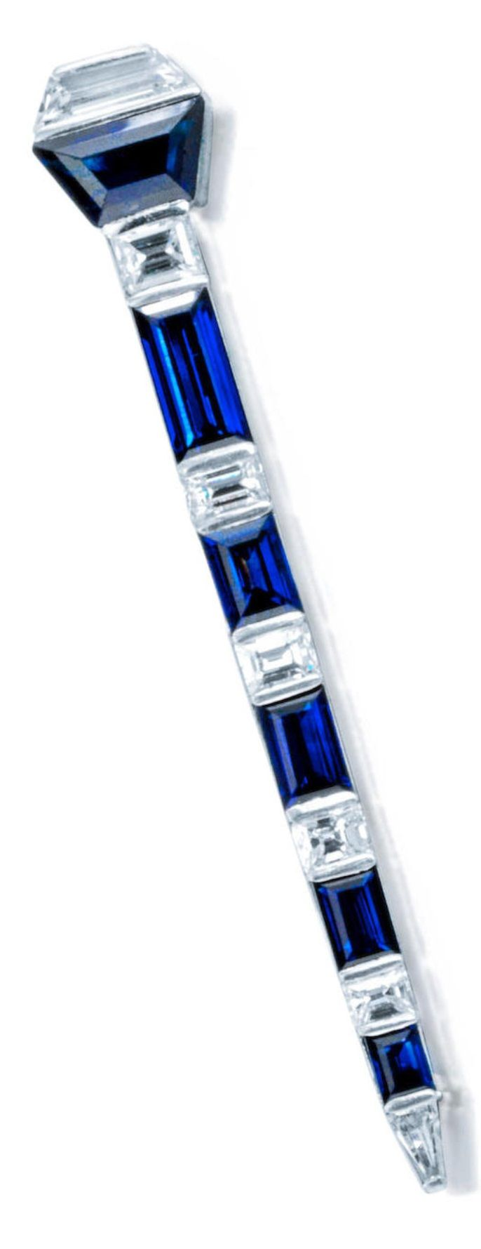 An Art Deco diamond and sapphire brooch, circa 1920. Of abstract design, set with alternating fancy-cut sapphires and diamonds; signed MD, no.8446, with maker's mark for Charles Holl and French assay mark; estimated total diamond weight: 1.35 carats; mounted in platinum; length: 2 13/16in.