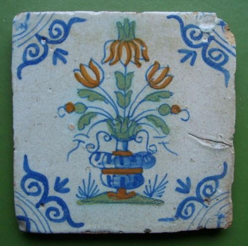 Delft tile with polychrome floral decoration- Dutch c1630