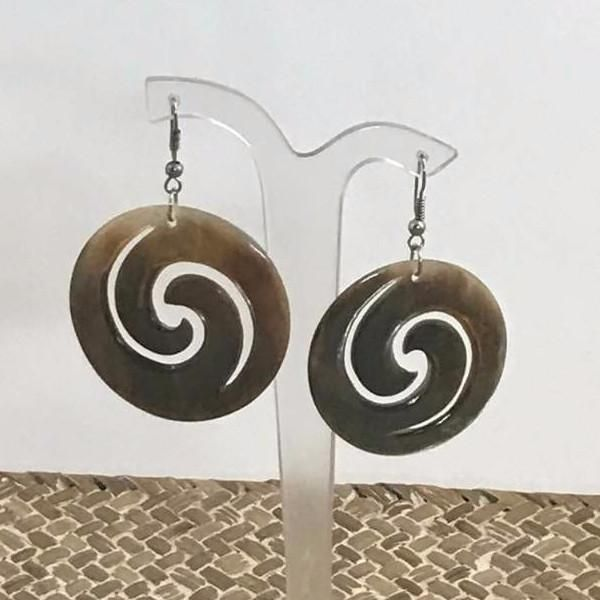 Gorgeous sea shell earrings designed from hand shaped polished shell swirls. Suspended from a simple hook clasp so as not to detract from the beauty of the shell itself.