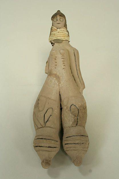 Doll. Date: 20th century Geography: Brazil. Culture: Caraja. Medium: Ceramic, yarn, string. Classification: Ceramics-Sculpture.
