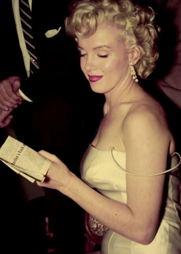 """Marilyn Monroe at a press conference to announce the formation of Marilyn Monroe Productions, 1955. """