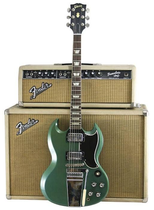 Vintage Gibson SG in Emerald green with a Cream Fender Bassman Amplifier with matching speaker cabinet.
