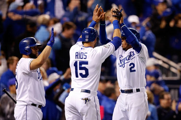 WORLD SERIES GAME 2 - The Royals' Alcides Escobar, right, and Alex Rios celebrate after scoring runs in the fifth inning against the Mets during Game 2 of the World Series at Kauffman Stadium on Oct. 28, 2015. (Photo by Sean M. Haffey/Getty Images)
