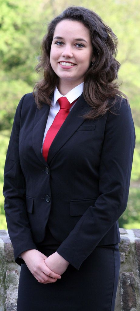 Student Girl Dressed In Black Suit White Shirt And Red Tie