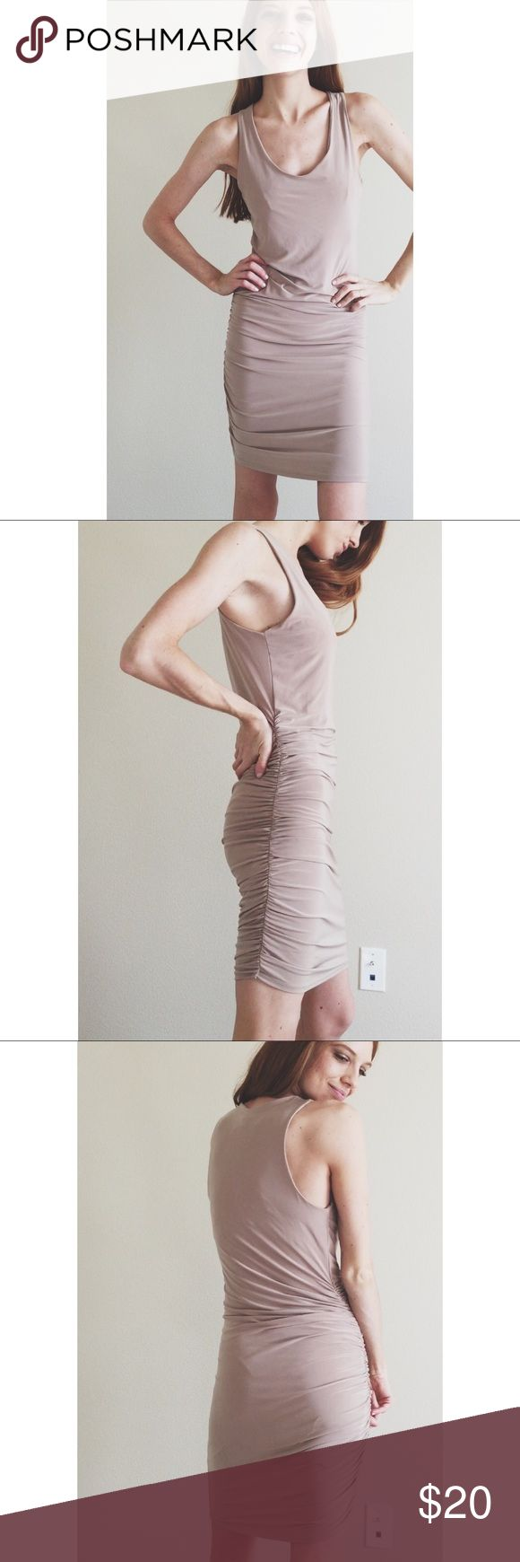 Nude Bodycon Dress This nude bodycon dress has ruching up the side that adds a little something special to an otherwise ordinary dress :) it is lined, so you can wear it confidently. Dresses Mini