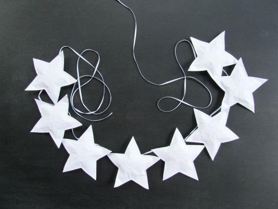 White paper star banner or garland for wall hanging decoration